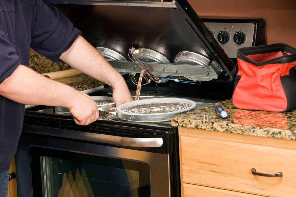 Appliance Handyman Technician Repairing Stove Scarborough